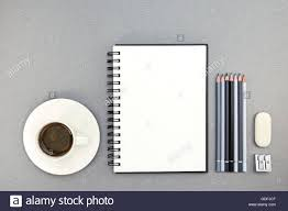 cup of coffee and notebook with drawing tools on desk top view