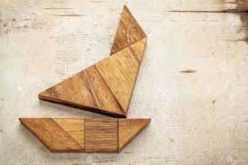 abstract picture of a sailing boat built from seven tangram wooden