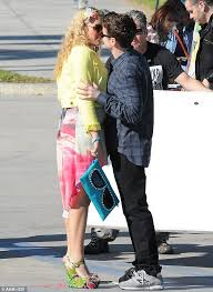 Cougar Town Memes - busy philips embraces co star dan byrd as they film cougar town