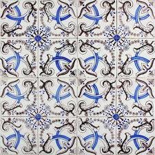 antique delft ornamental wall tiles with flower bow motifs
