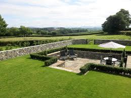walled garden design landscape farmhouse with pleached hedging oak