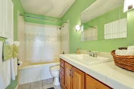 light green bathroom light green bathroom interior with white tile trim stock photo