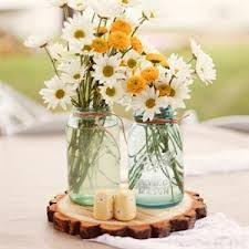 wedding flowers jam jars flowers in jam jars glass dishes for meat dairy