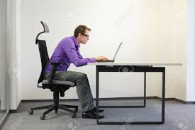 Laptop Desk Chair by Bad Sitting Posture At Laptop Man On Chair Stock Photo Picture