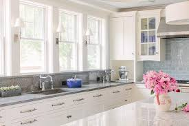 kitchen backsplash with white cabinets white kitchen cabinets with glazed blue backsplash tiles