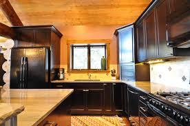 black kitchen cabinets in log cabin rustic log cabin rustic kitchen denver by mountain