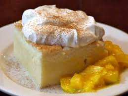 tres leches cake with mango someone left the cake out in the rain