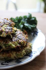 healthy zucchini fritters with chipotle dipping sauce being