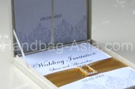 boxed wedding invitations couture silk invitation box set for wedding invitations handbag