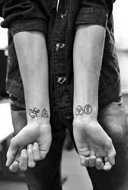 45 symbol tattoos we love