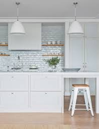kitchen style minimalist coastal kitchen with a white subway tile