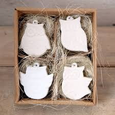 four ceramic owl decorations boxed by red berry apple