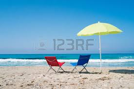 Beach Umbrella And Chairs Beach Umbrellas And Deck Chairs In Porto Giunco Beach Villasimius