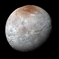pluto u0027s big moon charon reveals a colorful and violent history nasa