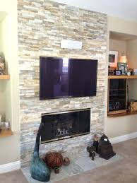 mount tv above fireplace into brick fireplace ideas
