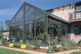 aluminum glass cathedral roof sunroom by sunboss room additions