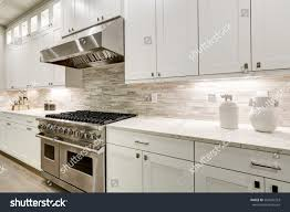 gourmet kitchen features white shaker cabinets stock photo