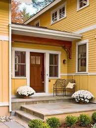 small porch with wall sconces and potted plants ways to decorate