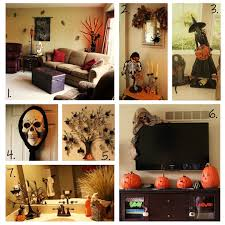 interior halloween home decor with pimpkins around the tv and