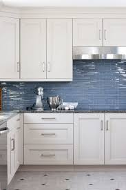 white kitchen cabinets with blue tiles designed by kristin peake interiors blue backsplash