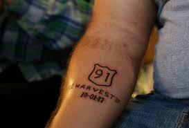 vigil attendee u0027s tattoo serves as reminder of survival after