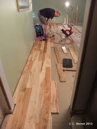 adding the spline and changing directions on our wood floor