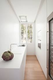 Galley Kitchen With Pass Through A Bright And Comfortable Apartment Interior Design In Madrid