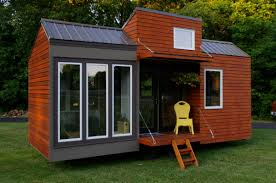 could you live in a tiny house tiny houses tall man and house