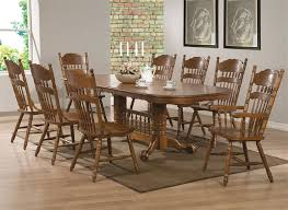 brooks 7 piece dining set in oak finish by coaster 104271