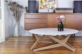 Shape Shifting Furniture Shape Shifting Table Can Transform From Coffee Setting To Dining