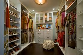 what is a walk in closet clothes hanger attached on beige painted wall walk in closet small