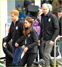 prince william gets drenched in water at london marathon photo