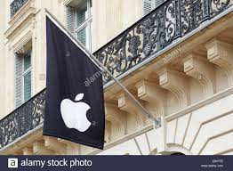 paris apple store apple logo on black flag in paris apple store stock photo