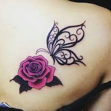rose flower and tribal butterfly tattoo on right back shoulder