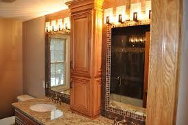 Wooden Bathroom Wall Cabinets Bathroom High Brown Wooden Cabinet With Two Doors Between Mirror