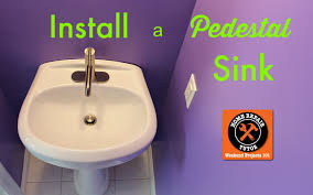 how to install a pedestal sink and faucet by home repair tutor