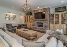 beautiful livingroom beautiful living room features a brick fireplace accented with