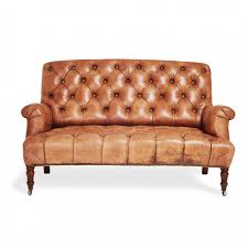 brown leather tufted sofa with wooden legs for small living room