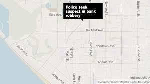 police look for a thin man who robbed a huntington beach bank