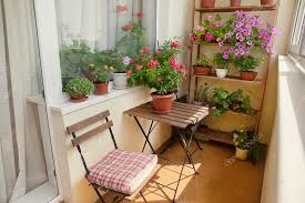 beautiful balcony beautiful balcony with small table chair and flowers stock
