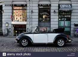 volkswagen buggy convertible person sitting in classic black and white volkswagen beetle stock