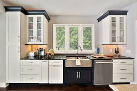 white kitchen cabinets with wood crown molding open floor plan in black white kitchen design cliqstudios