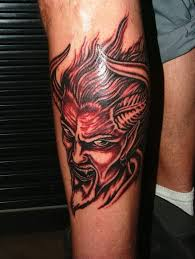 dangerous and simple satan head tattoo design on men leg golfian com