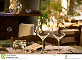 wine glasses and table setting in restaurant stock images image