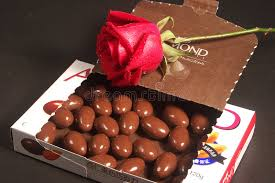 almond chocolates and rose stock photo image of snack 4953966