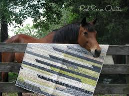 masculine jelly roll quilt made using authentic by sweetwater for