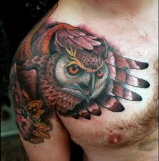 40 speechless owl tattoo on shoulder