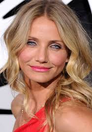 cameron diaz wears pink lipstick with a red dress to green hornet