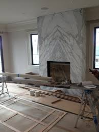 contemporary slab stone fireplace calacutta carrara marble book