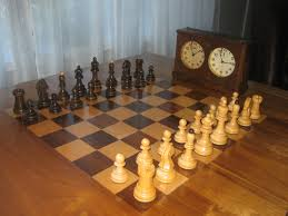maple and walnut chess table with vintage dubrovnik set chess